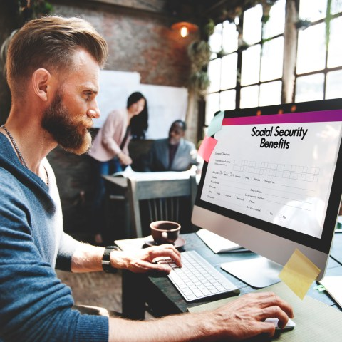 Man sitting at computer setting up My Social Security account online