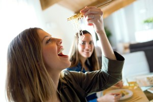 woman eating food at a restaurant