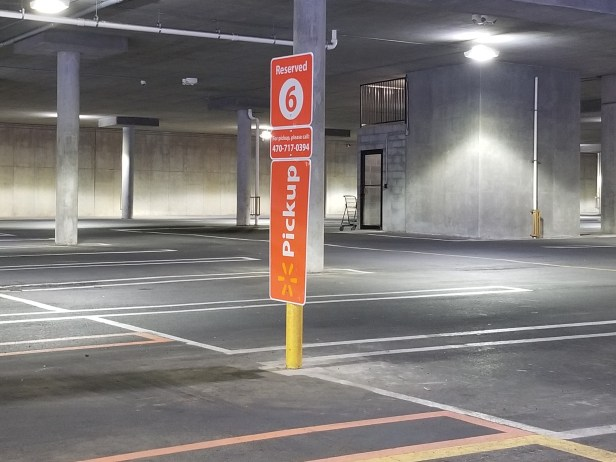 Orange signs lead you to Walmart's grocery pickup area