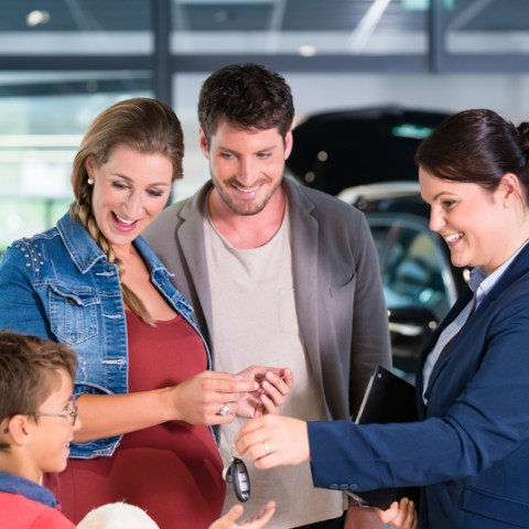 car dealer with family