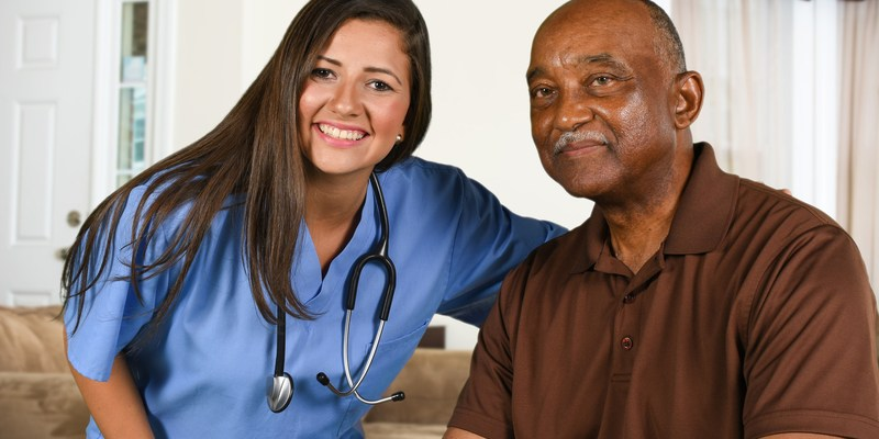 healthcare senior citizen nurse smiling via dreamstime