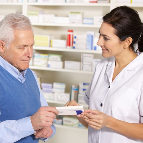 pharmacist with senior citizen