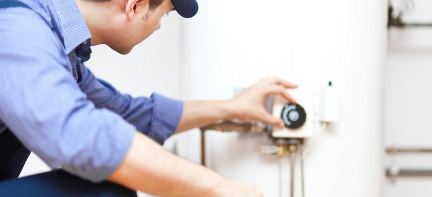 Plumber repairing a hot-water heater