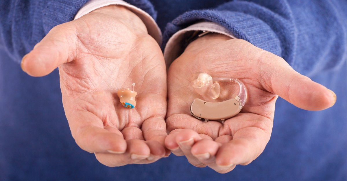 Hearing aids in a man's hand