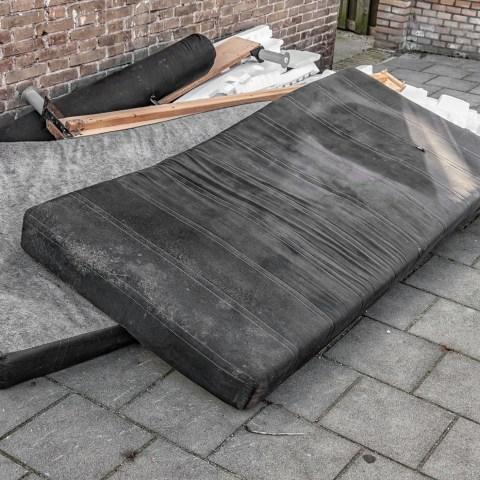 used mattresses dumped on the street
