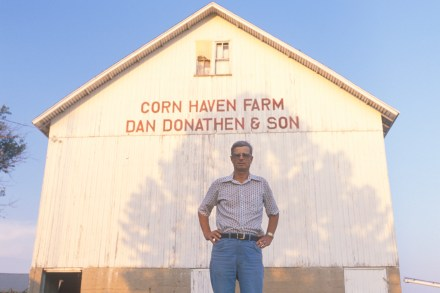 Farmer standing in front of corn barn in South Bend, IN