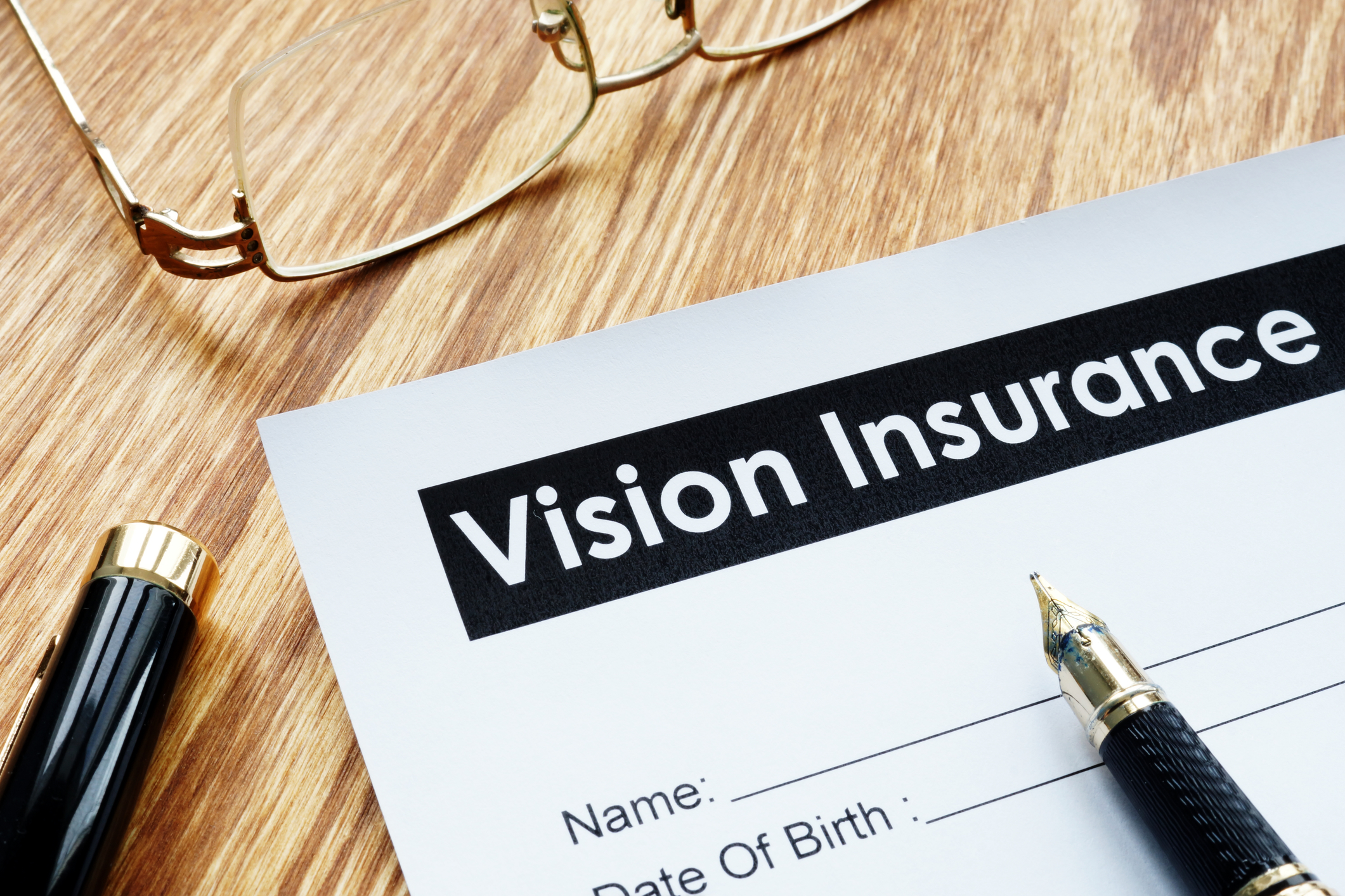 Vision Insurance application form and glasses