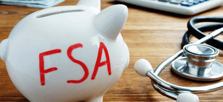Piggy bank with flexible spending account FSA for health care written on it