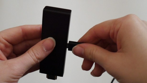 Plugging the Micro USB cable into the Amazon Fire TV Stick.
