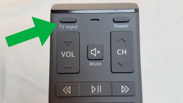 TV input button on a television remote.