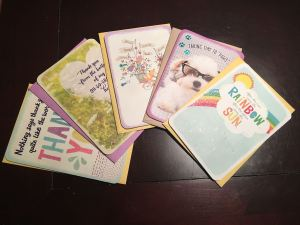 A pile of five free Hallmark greeting cards