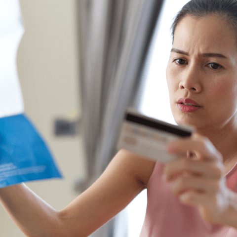 Stressed woman with credit card statement