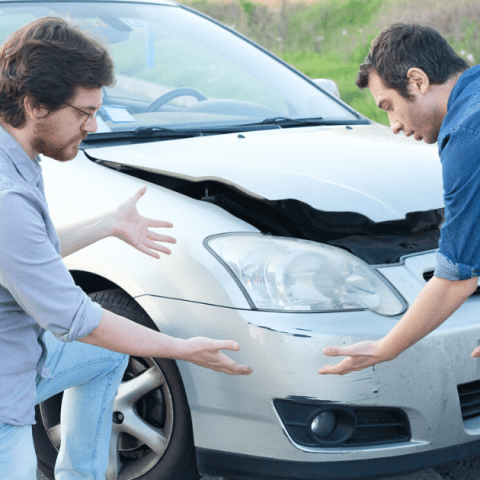two angry men arguing over an auto accident