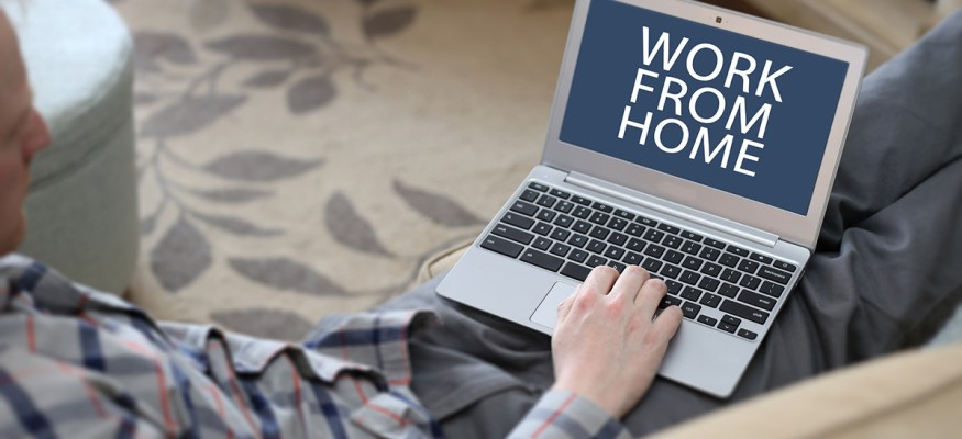 Job seeker on laptop looking for work-from-home jobs