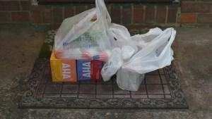 Receiving Walmart grocery delivery on your doorstep.