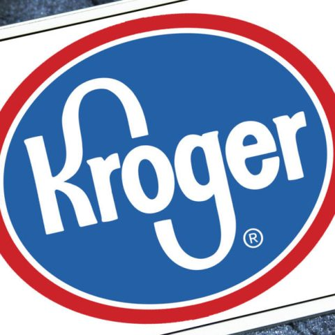 Kroger logo displayed on a digital screen to represent ordering groceries online