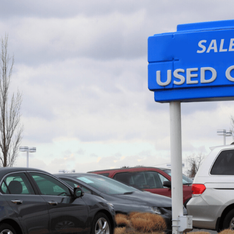 used cars including sedans and SUVs on sale at dealership lot