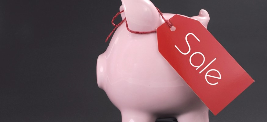Piggy bank with sale sign