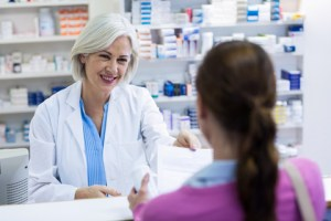woman talking to pharmacist about her prescription