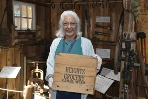 Two Rivers Heritage Museum Gayle Godtilbsen with collapsible wooden box from Heights Grocery that was located Division Street in Camas