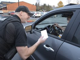 WPD officer Kelly Anderson catching WHS student drivers doing good. (2)