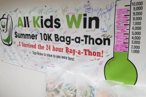 All Kids Win Olympia sign