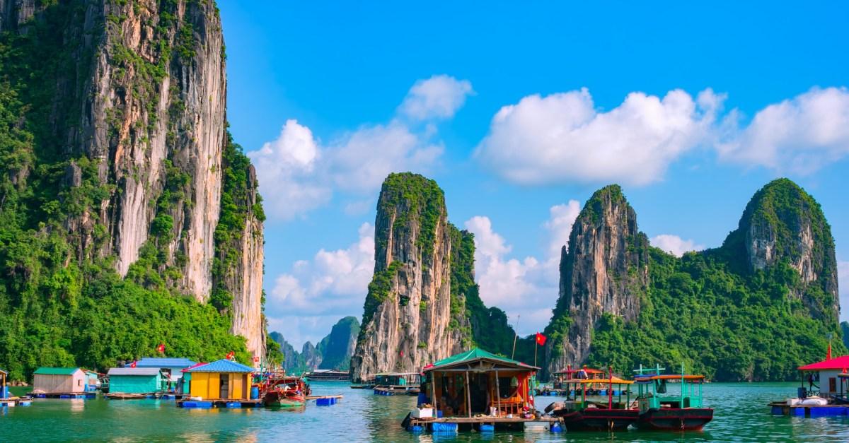 Floating village, rock island, Halong Bay, Vietnam