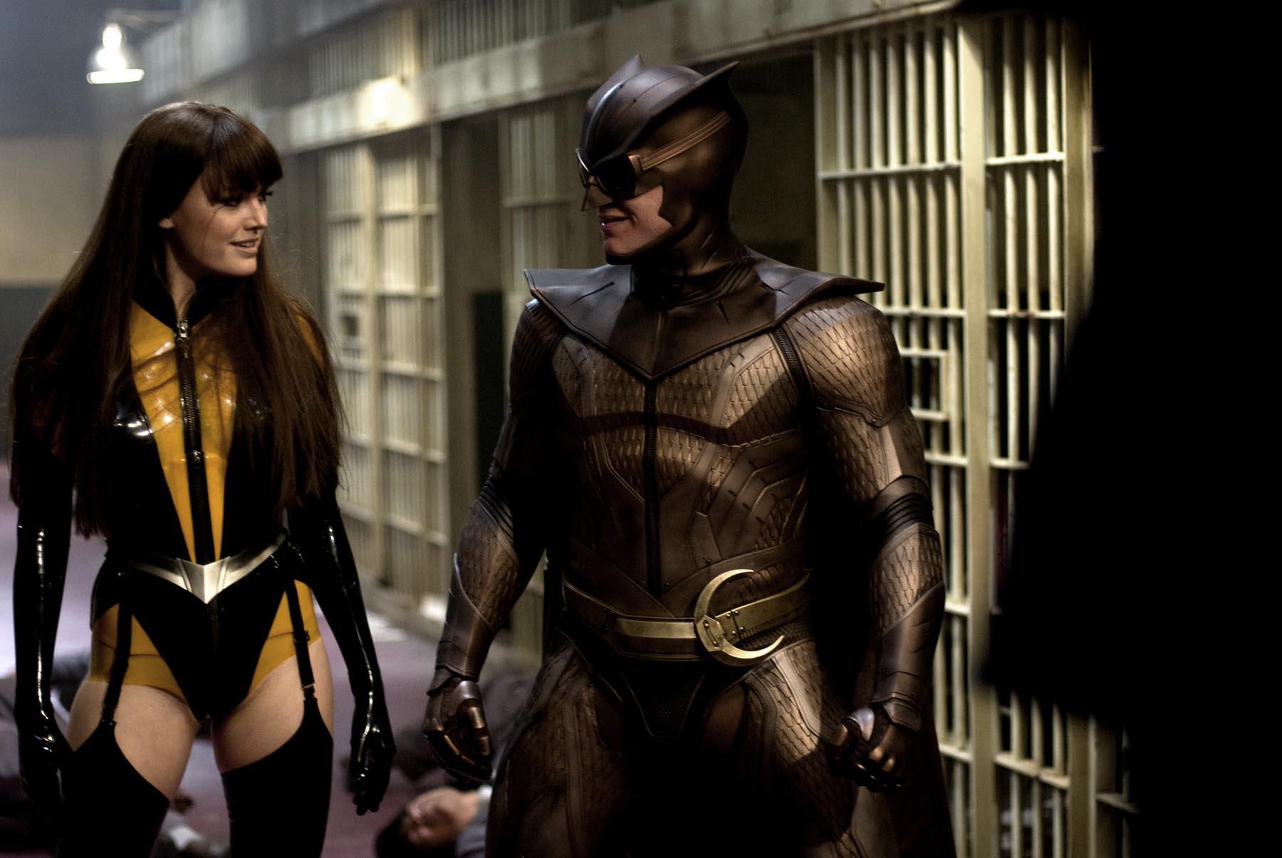 "Malin Akerman, left, and Patrick Wilson play superheroes in ""Watchmen."""