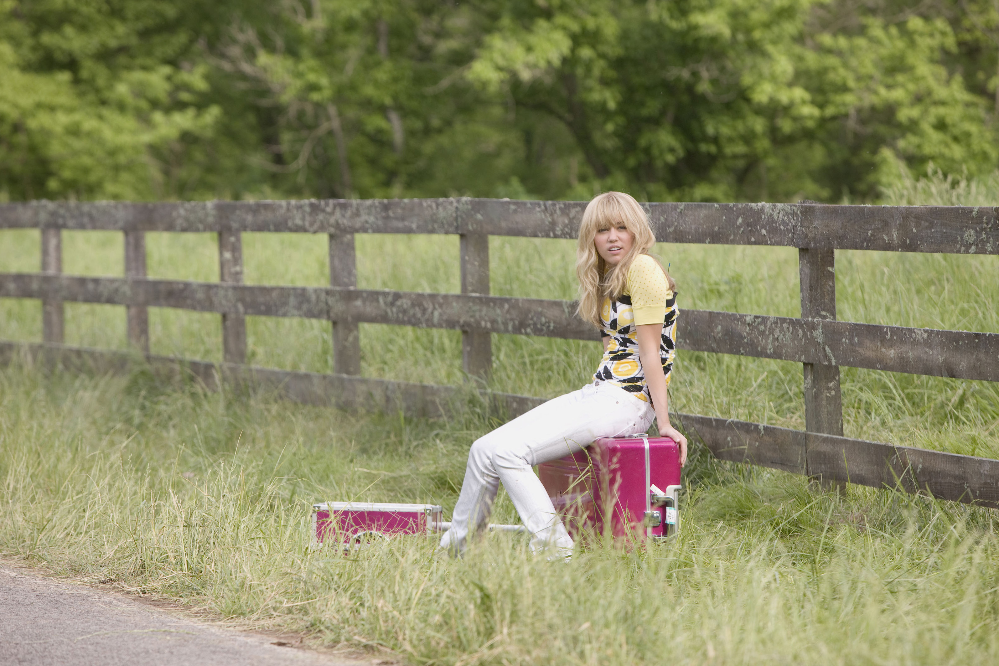 """Miley Stewart (Miley Cyrus) contemplates country life in """"Hannah Montana: The Movie."""""""