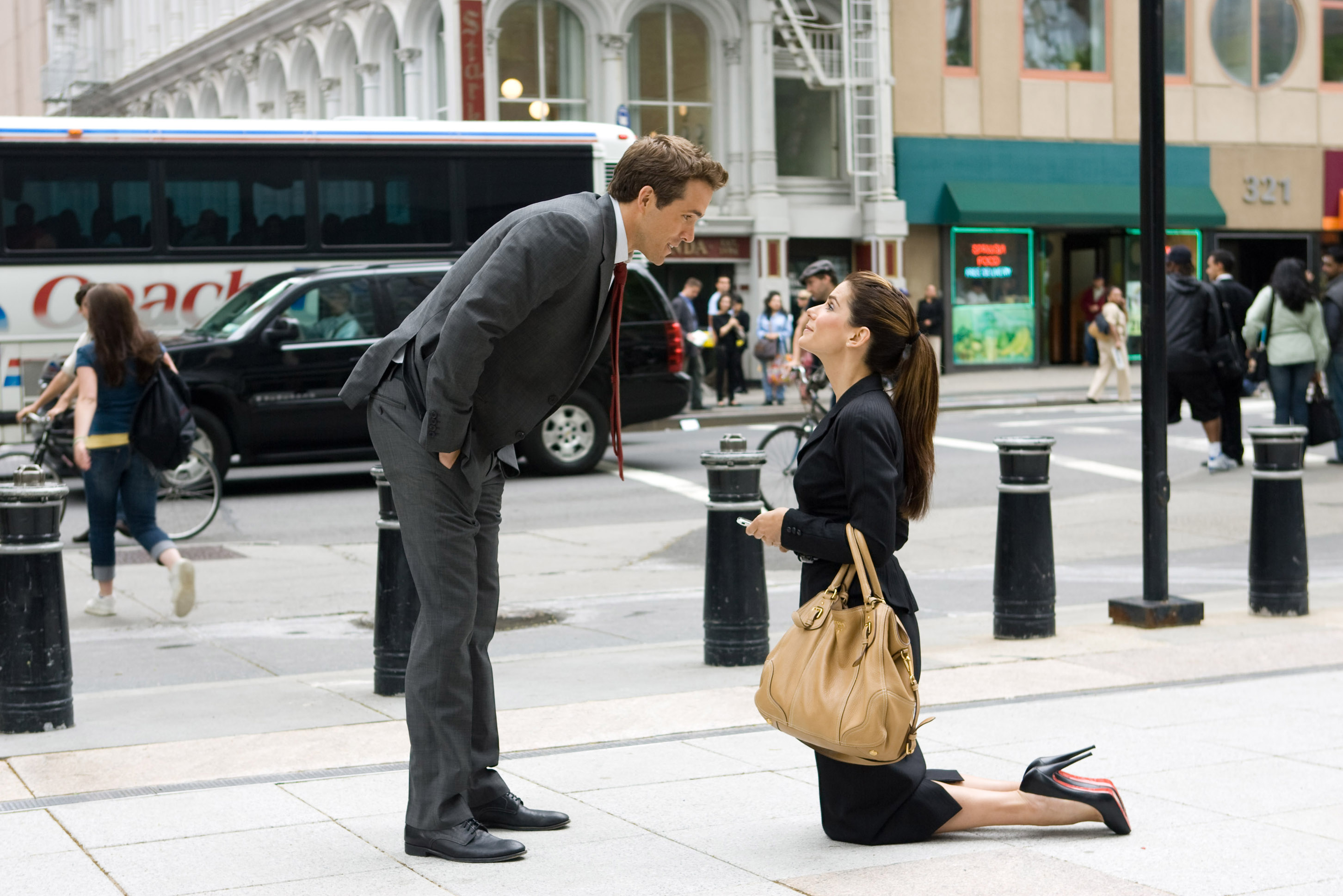 """Ryan Reynolds, left, and Sandra Bullock star in the new romantic comedy """"The Proposal."""""""