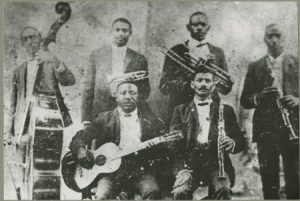 The only known photo of Boddy Bolden (he's standing next to the bass).