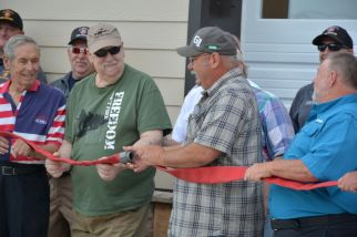Uncoupling of a fire hose for the new Clarksville Fire Rescue Maintenance Garage on Wed July 7 2021 (Lee Erwin).