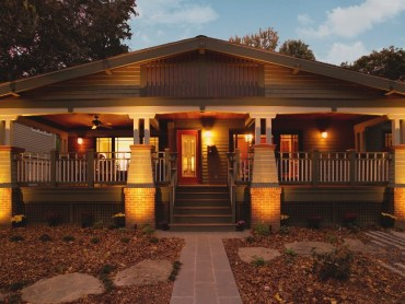 Craftsman front porch addition with painted wood shingles and copper column caps