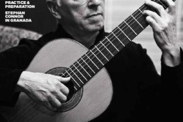 CG Magazine cover with black and white photo of John Williams playing a nylon-string guitar