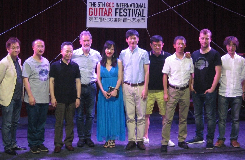 Artistic director Xuefei Yang (center) with various players and judges