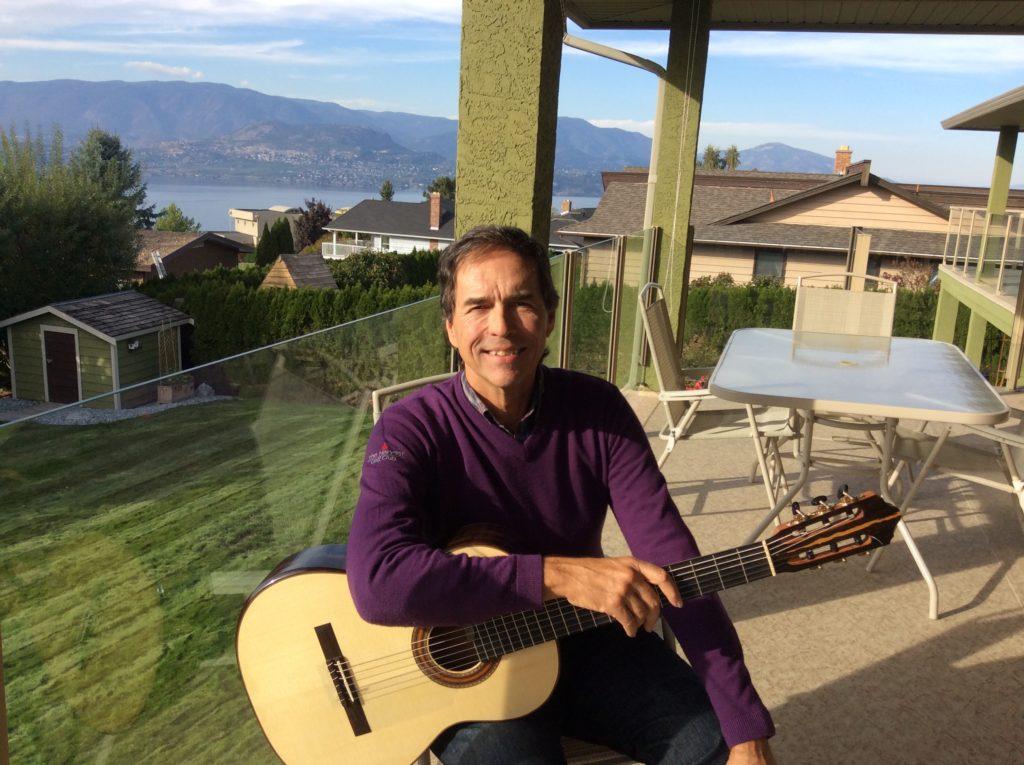 Article author Alan Rinehart holding guitar