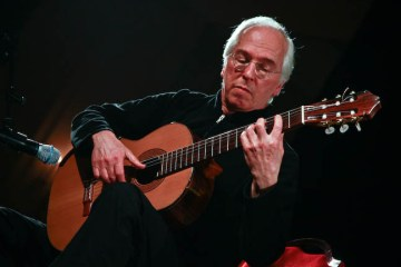 John Williams playing guitar