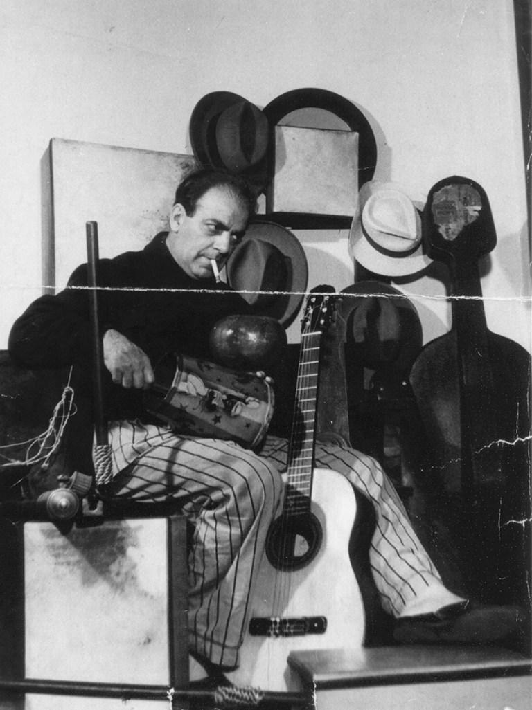 Composer and classical guitarist Heitor Villa-Lobos with guitar