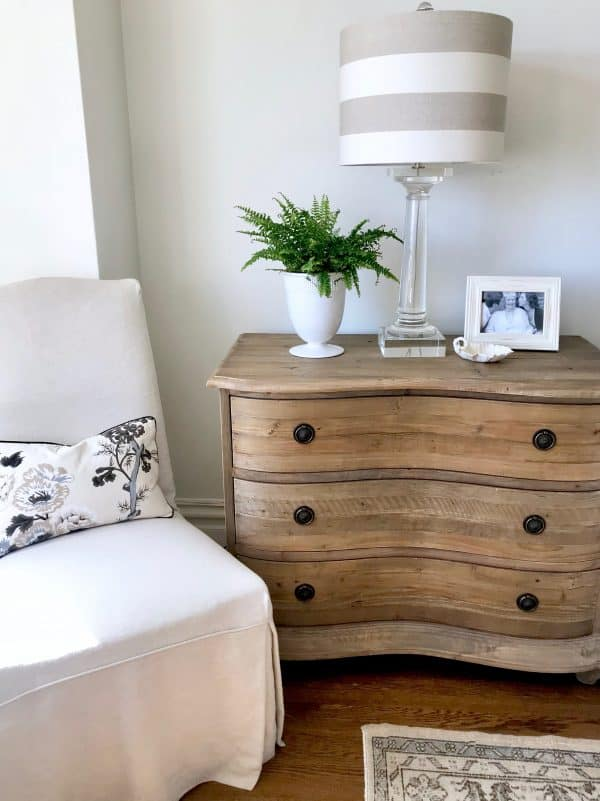 Pine chest with crystal lamp with striped shade