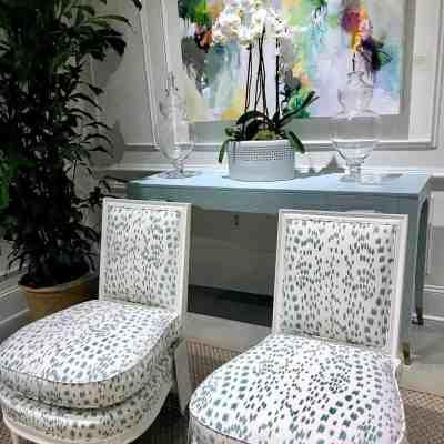 White chairs with schumacher leopard print