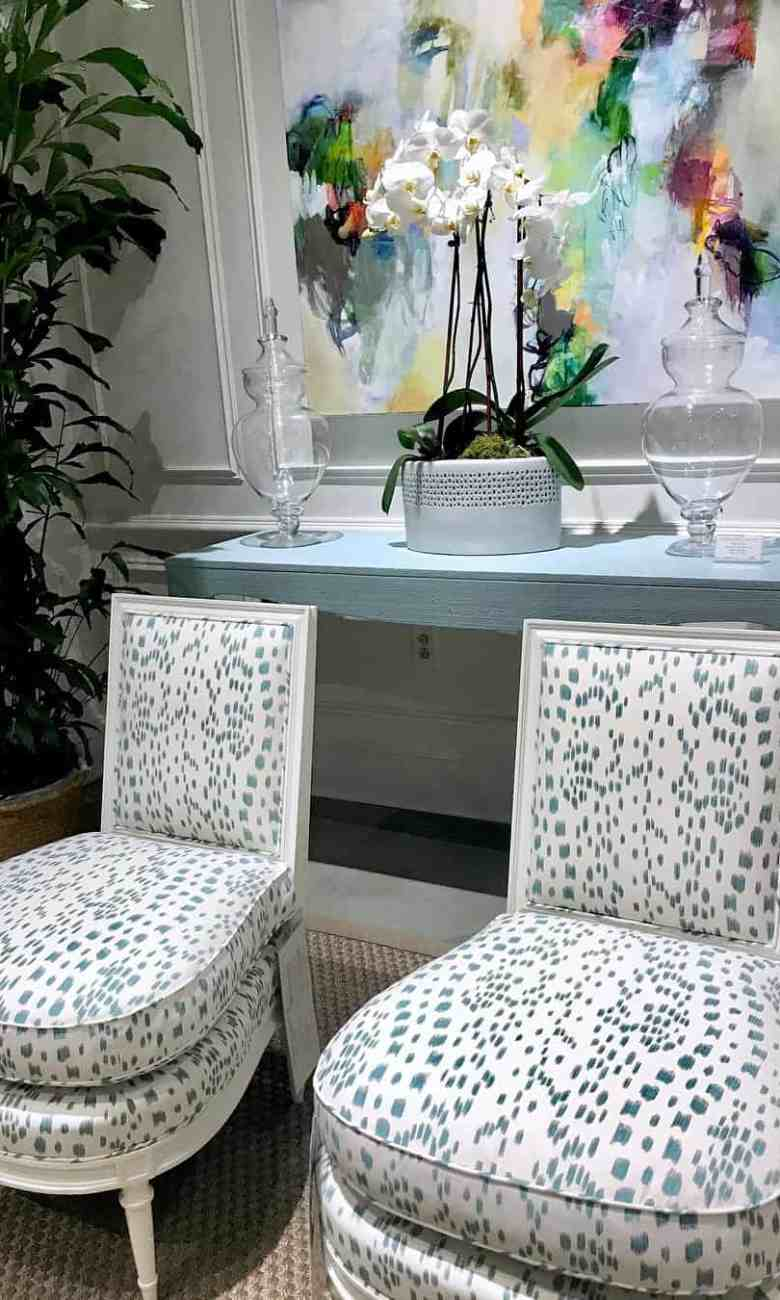 White chairs with schumacher leopard print