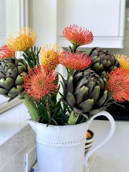 floral arrangement with artichokes