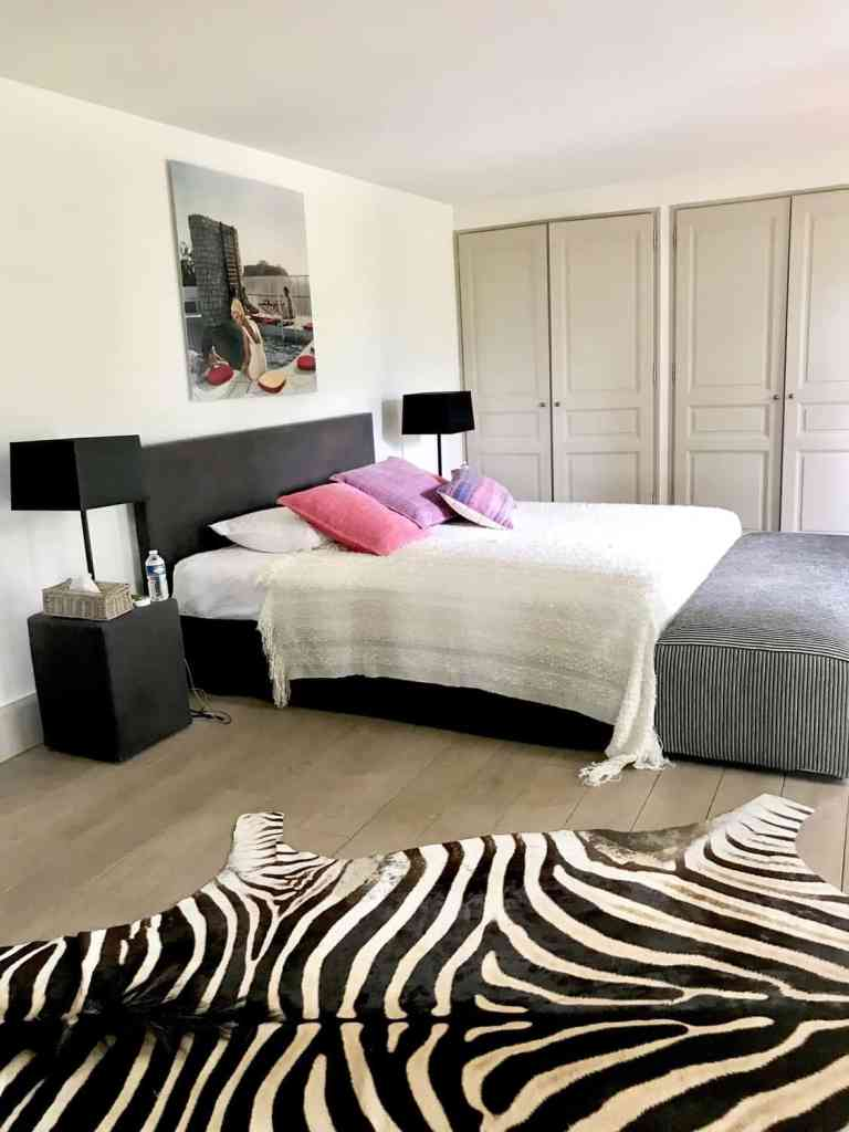 bedroom with zebra rug in farmhouse manor in Provence