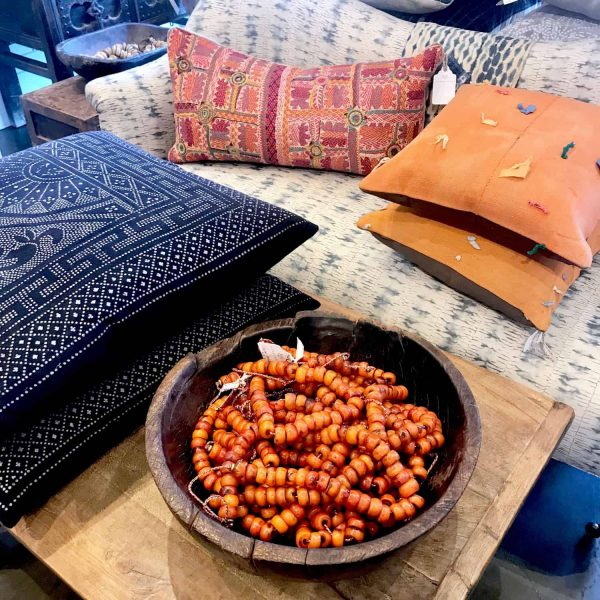 global pillows and orange African beads