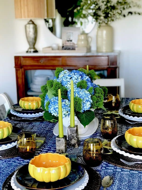 Blue and White Thanksgiving Table setting with pumpkin bowls