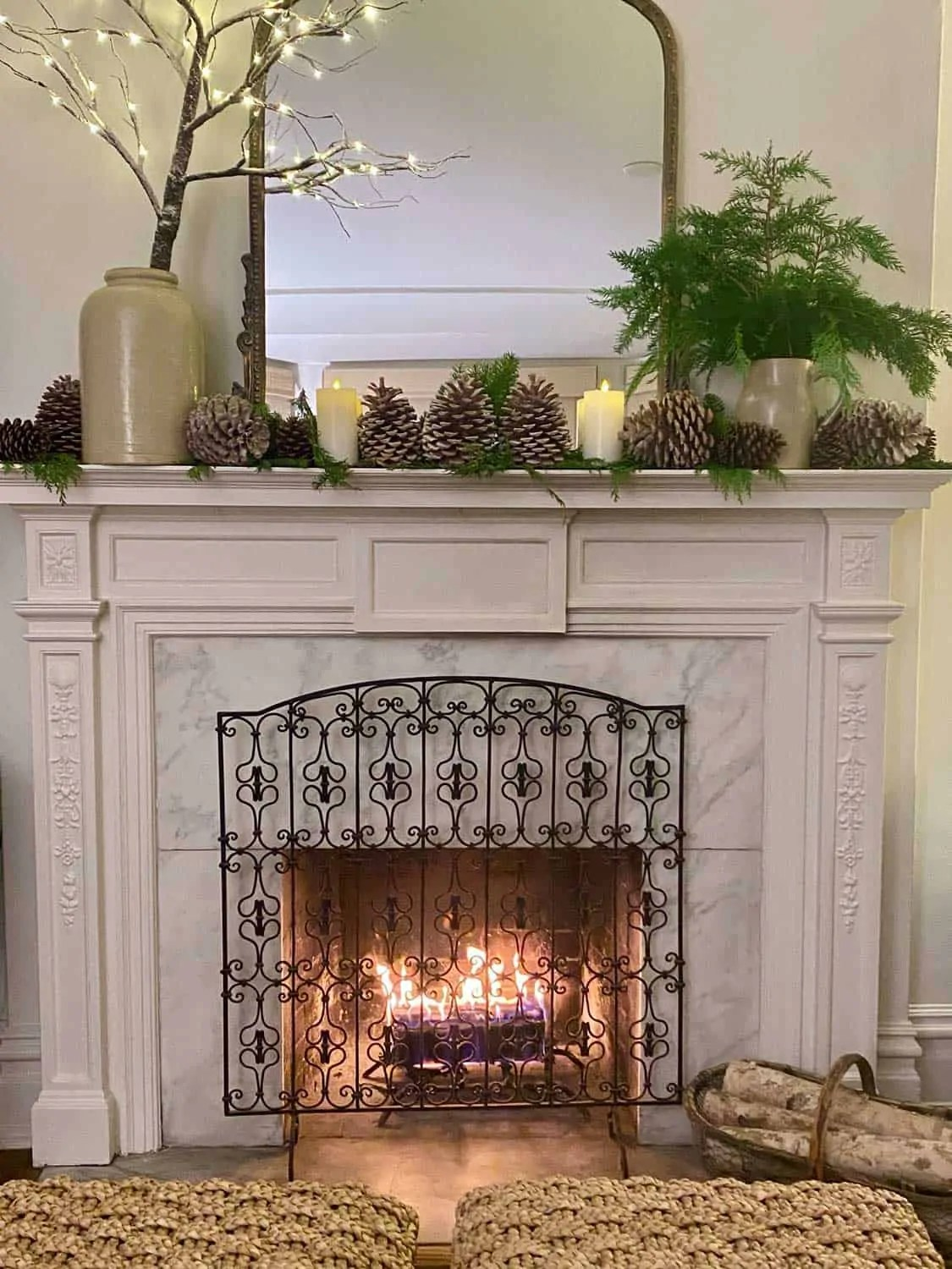 Christmas White fireplace in the evening with candles and a fire in the fireplace