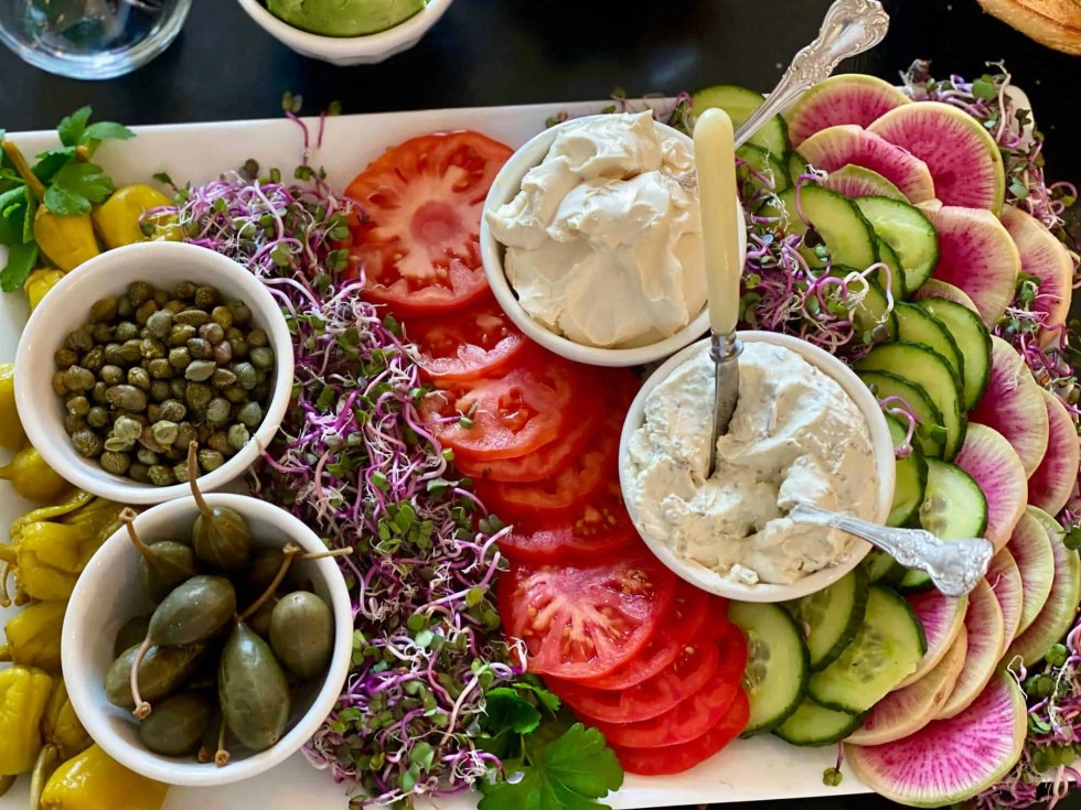 capers, tomatoes and cream cheese for bagel toppings