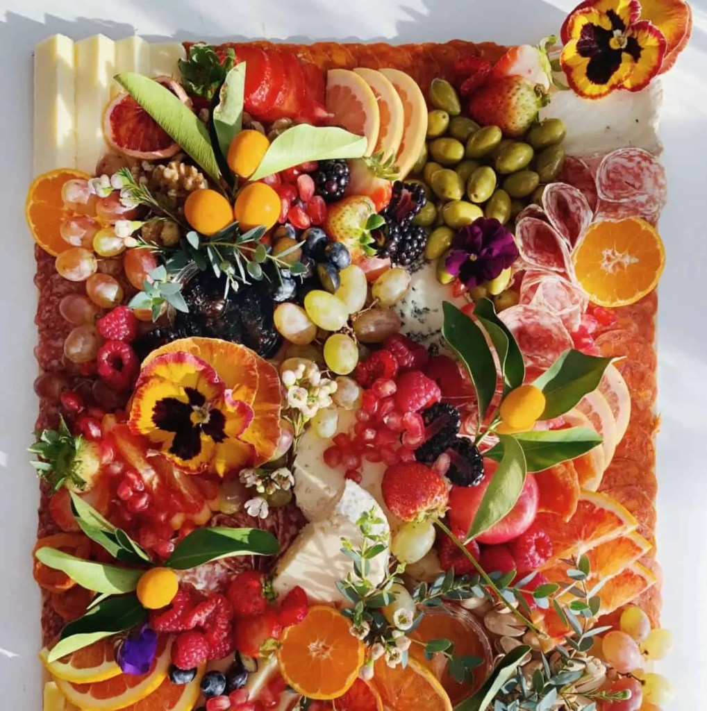 Fruit and Cheese board with edible flowers