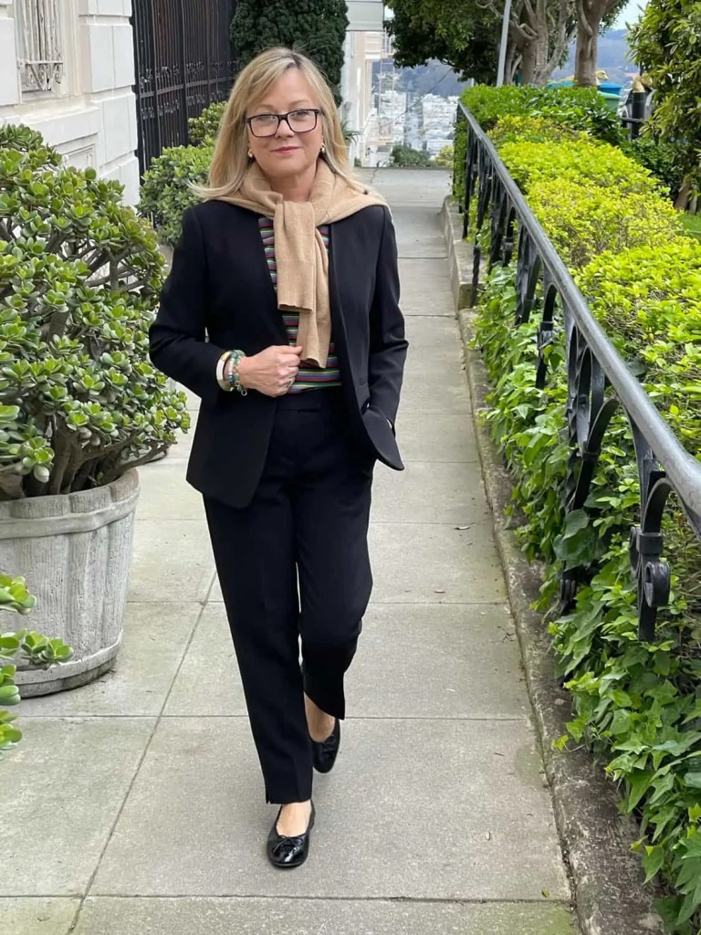Mary Ann Pickett with Black pant suit and cashmere sweater scarf