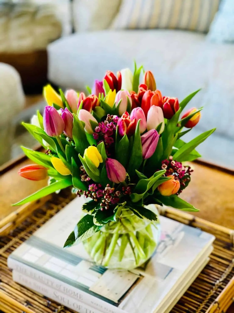multi-colored tulips on coffee table
